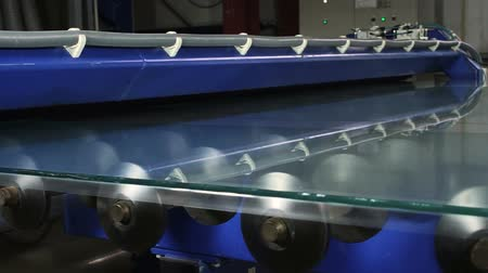 glass structure : Contemporary equipment. Modern robotic line for production of frosted glass. HD Stock Footage