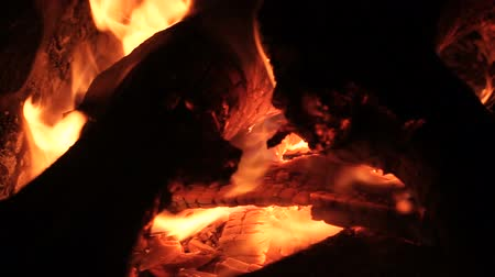pyre : Cooking on the open fire. Close-up of firewoods burning into red flame. HD