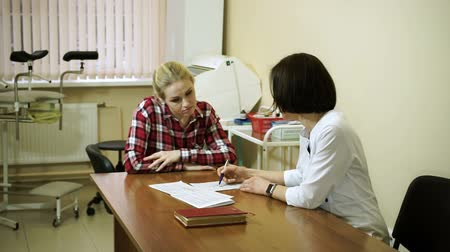 gynaecology : A visit to the doctor. A young woman is on consultation at gynecologist. HD