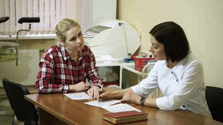 gynaecologist : A visit to the doctor. A young woman is on consultation at gynecologist. HD