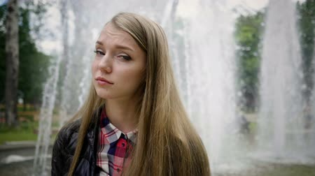 pléd : Portrait of beautiful young blonde caucasian woman looking sad. Slow motion. HD