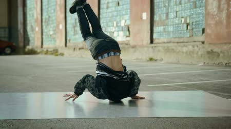 breakdancing : Hip-hop and breakdancing. Breakdancer dancing in the street. Slow motion. HD
