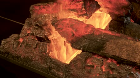 charcoal stove : Home interior. Close-up shot of warm cozy burning fire in electric fireplace. 4K