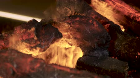 wood burner : Home interior. Close-up shot of warm cozy burning fire in electric fireplace. 4K