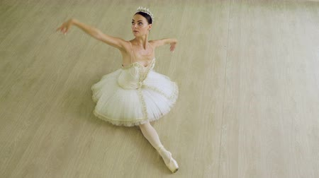 tiara : Classical ballet. Top view of ballerina dancing in pointe shoes in dance studio. 4K