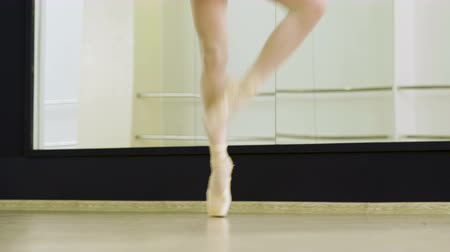 kotník : Close-up shot of ballerinas feet dancing on tiptoe in pointe shoes in dance studio. 4K