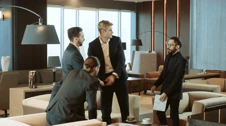 do widzenia : One man saying goodbye and shaking hands to three businessmen after a business meeting. 4K