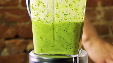 grated : Preparation of pesto sauce from fresh basil, parmesan cheese, olive oil and garlic with a blender. 4K