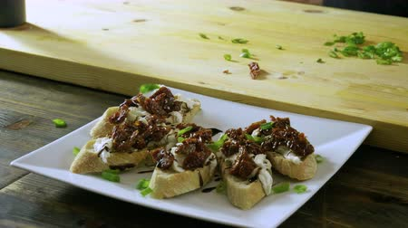 dried tomatoes : Italian food. Bruschetta with dried tomatoes, mozzarella cheese, balsamico sauce, green onion. 4K