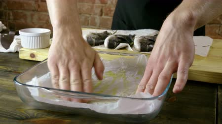 baking dishes : Cooking of three sea bass. The cook preparing fresh fish for baking. 4K Stock Footage