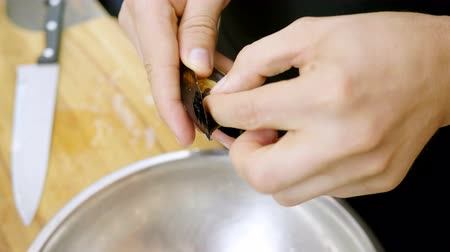 shellfish recipe : Close-up shot of mens hands preparing mussels at the cooking master class. 4K