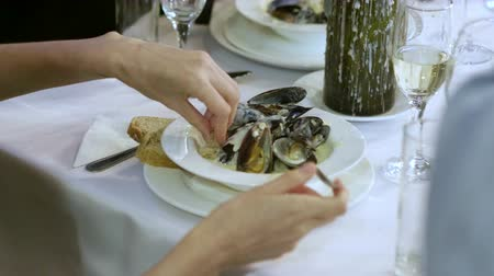 shellfish dishes : Group of people eating prepared delicious mussels in cream at culinary school. 4K