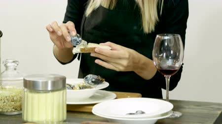 eaten : The young woman eating delicious mussels and bread at cooking master class. 4K Stock Footage