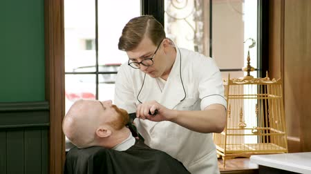trim : Shaving of beard. Barber cutting mens face hair with beard trimmer at barbershop. 4K