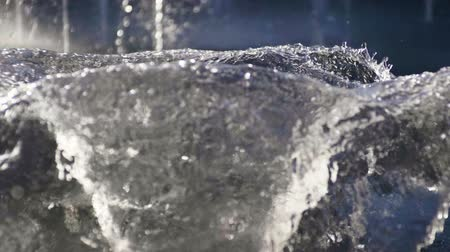 aqua park : Close-up shot of water drops of fountain in the summer park. Slow motion. HD Stock Footage