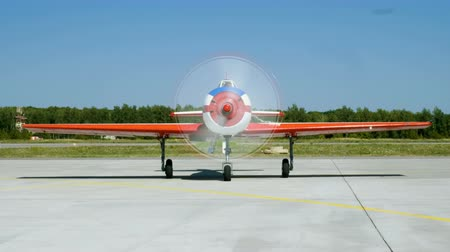aerobatic : Medium shot of an old aircraft with turning propeller located at airport. 4K Stock Footage
