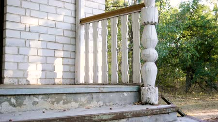 veranda : Stairs on the porch of a country house in the autumn forest. Slow motion. HD