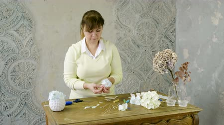 bijouterie : The woman making artificial hydrangeas flowers of white and beige paper. 4K