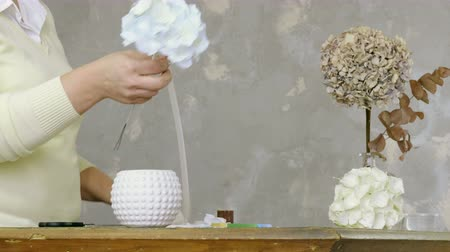 bijuteria : The woman making artificial hydrangeas flowers of white and beige paper. 4K