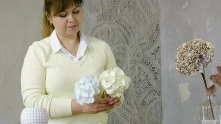 artificial flower : The woman making artificial hydrangeas flowers of white and beige paper. 4K