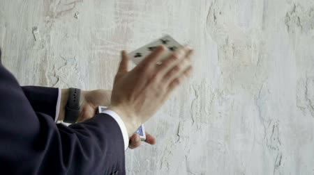entertainers : Close-up of magicians hands performing card trick. Slow motion. HD