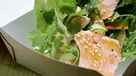 filet : European food. Close-up shot of salad with smoked salmon, herbs and vegetables. 4K Stock Footage