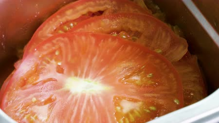 tomate cereja : Vegetables for salad preparation. Close-up shot of chopped tomatoes. 4K Stock Footage