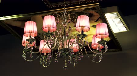luster : Crystal lamp. Vintage elegant chandelier hanging on the ceiling in a luxury living room. 4K