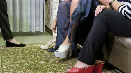 high heeled shoe : Mid-adult pretty woman trying on womens shoes with high heels in shop. 4K Stock Footage