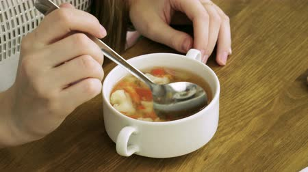 горошек : Healthy food. Close-up shot of young blonde woman eating vegetable soup at restaurant. 4K Стоковые видеозаписи