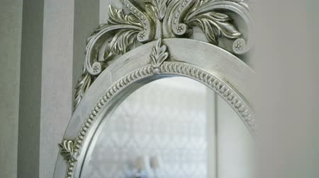 victorian : The interior of an elegant living room. Close-up of mirror hanging on the wall. Slow motion. HD Stock Footage