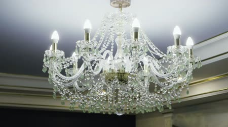 luster : Crystal lamp. Vintage elegant chandelier hanging on the ceiling in a luxury living room. Slow motion. HD