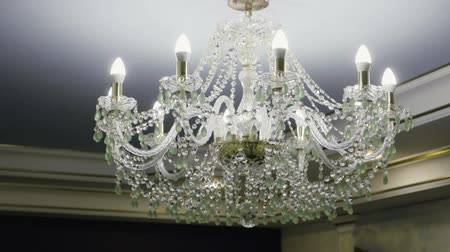 cielo raso : Crystal lamp. Vintage elegant chandelier hanging on the ceiling in a luxury living room. Slow motion. HD