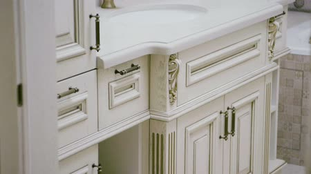 ízléses : The interior of a modern bathroom. Close-up shot of furniture. Slow motion. HD Stock mozgókép