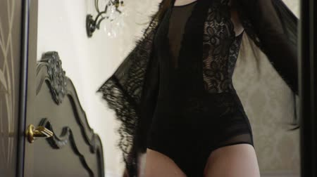almofadas : Happy woman dressed in black lingerie having fun and dancing with a pillow on a luxurious bed in an expensive bedroom. Slow motion. HD Stock Footage