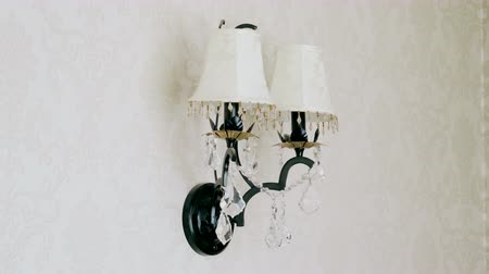 кулон : Crystal lamp. Vintage elegant chandelier hanging on the wall in a luxury living room. 4K