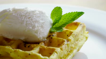 viennese : Sweet breakfast. Close-up shot of viennese waffles with ice cream and mint on a white plate. 4K