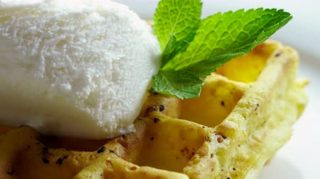 belga : Sweet breakfast. Close-up shot of viennese waffles with ice cream and mint on a white plate. 4K