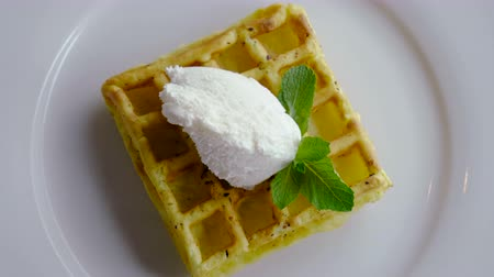 viennese : Sweet breakfast. Top view of viennese waffles with ice cream and mint on a white plate. 4K