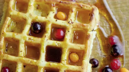 buckthorn : Sweet breakfast. Top view of viennese waffles with fresh berries, honey, syrup on a glass plate. 4K