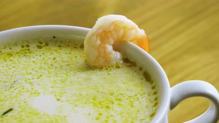 morina : Healthy food. Close-up shot of cream seafood soup with shrimp cooked in fish broth. 4K