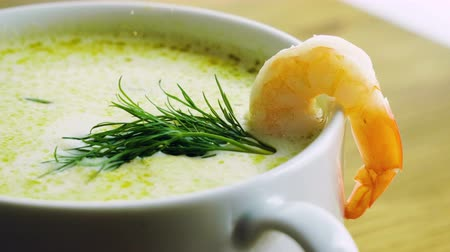 треска : Healthy food. Close-up shot of cream seafood soup with shrimp cooked in fish broth. 4K