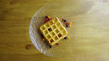 gofret : Sweet breakfast. Top view of viennese waffles with fresh berries, honey, syrup on a glass plate. 4K