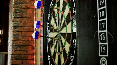dart : Close-up shot of dart arrow hitting in target center of dartboard in game of darts. 4K Stock Footage