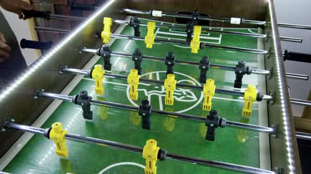 cricket : Sport, game concept. Foosball. People playing a table football or kicker with miniature players. 4K