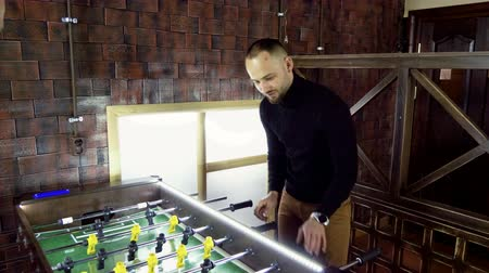 cricket : Sport, game concept. Foosball. One man playing a table football or kicker with miniature players. 4K Stock Footage