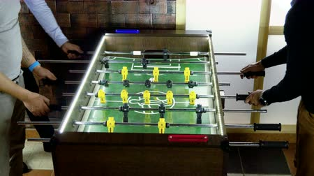 cricket : Sport, game concept. Foosball. Three men playing a table football or kicker with miniature players. 4K
