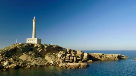 The lighthouse at Cabo de Palos. Landscape of Mediterranean coast in Spain. 4K