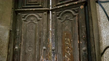 Vintage large wooden gate or doors with a padlock on it. Cartagena. Spain. 4K