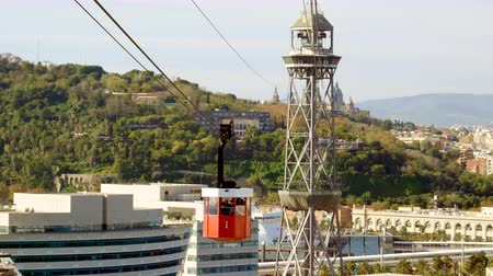 Cable car to Montjuic mountain. City view of Barcelona. Spain. Europe. 4K Stock mozgókép